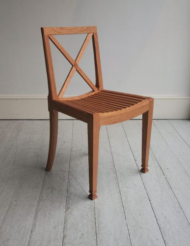 Orangerie Chair I With Slatted Seat And Cross-Back. Suitable As An Outdoor Dining Chair. Shown Here in Brown.